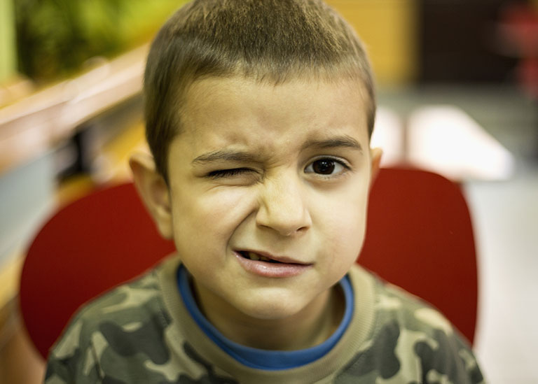 Boy with tic in eye